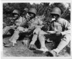 Four soldiers eating rations.