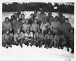 Group photo of soldiers in the snow.