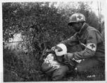 Medic dressing a head wound.